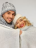 bright picture of family couple under warm blanket