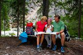 Family on hike, Family planning mountain trek - Dolomites - Italy