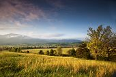 stock photo of cade  - Beautiful glow of Cades Cove in the Smoky Mountains - JPG