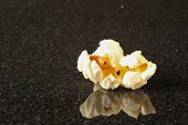 One Popcorn Kernel On A Black Background