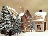 foto of gingerbread house  - Little snow covered cottages made from gingerbread - JPG
