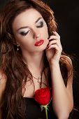 Elegant Woman With Red Rose. Glamour Portrait Of Female Makeup