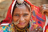 foto of gypsy  - Beautiful Traditional Indian woman in sari costume covered her head with veil - JPG