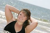 image of plus size model  - one attractive plus size model posing at the beach  - JPG