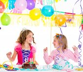 children kid in birthday party dancing happy laughing with balloons serpentine and garlands