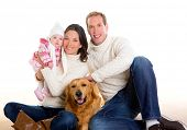 stock photo of puppies mother dog  - Baby girl mother and father family happy in winter with golden retriever dog - JPG