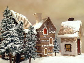 stock photo of gingerbread house  - Little snow covered cottages made from gingerbread - JPG