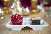 Fancy Gourmet Cupcake And Slice Of Cake At A Wedding