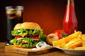 stock photo of hamburger  - fast food menu with big tasty hamburger vegetables french fries tomato ketchup and cola drink - JPG