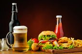 stock photo of hamburger  - fast food menu with hamburger chicken nuggets french fries and beer - JPG