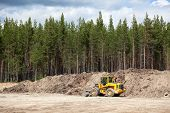 Yellow Excavator In Sandpit