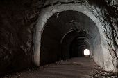Dark Abandoned Tunnel Interior Perspective With Glowing End