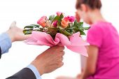 stock photo of broken heart flower  - A woman with broken heart and man with flowers wanted forgiveness - JPG