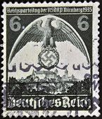 A stamp printed in Germany shows nazi eagle badge