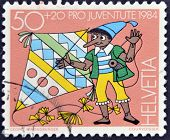 Switzerland - Circa 1984: A Stamp Printed In Switzerland Shows Pinocchio With A Kite, Circa 1984