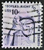A stamp printed in the USA shows Contemplation of Justice (statue J. E. Fraser)