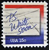 A stamp printed in USA shows an envelope with the words p.s write soon