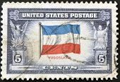 UNITED STATES - CIRCA 1943: stamp printed in USA shows Flag of Yugoslavia circa 1943