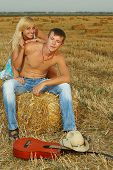 Couple Of Lovers In The Hay With Guitar