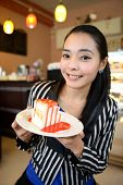 foto of pie-in-face  - The beautiful smiling asian young woman with a cake - JPG