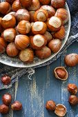 stock photo of filbert  - Hazelnuts on a plate on a table - JPG