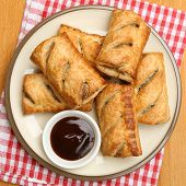 Sausage rolls with brown sauce dip.