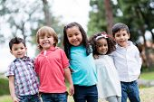 stock photo of bonding  - Happy group of kids smiling at the park - JPG