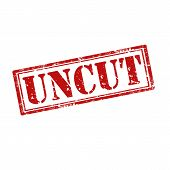 stock photo of uncut  - Grunge rubber stamp with word Uncut - JPG