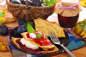 Pancakes With Plum Confiture And Whipped Cream