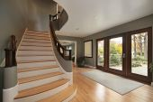 stock photo of entryway  - Foyer in luxury home with long staircase - JPG