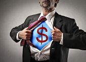 businessman opens shirt and shows superhero suit