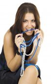 Woman Gnawing Beads