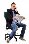 picture of shock awe  - A man looks surprised shocked while reading a newspaper speek phone white background - JPG