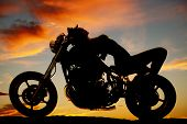 Woman Lay On Back Of Motorcycle Silhouette