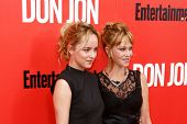 NEW YORK-SEP 12: Dakota Johnson (L) and Melanie Griffith attends the