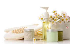 picture of cosmetic products  - body care products with daisies on white background - JPG