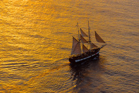 picture of sloop  - A sailing ship in the mediterranean sea at sunset - JPG