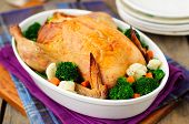 Whole Roast Chicken Stuffed With Bread And Cheese Served With Steamed Vegetables