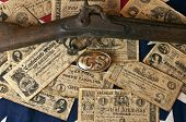 stock photo of musket  - confederate money - JPG