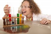 Crazy Woman Scientist With Test Tubes Grab Red