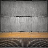 Abstract Empty Industrial Interior With Concrete Wall And Rusted Floor