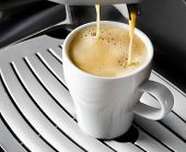 Coffee Maker Pouring  Espresso Coffee In  Cup