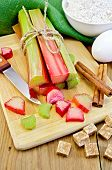 Rhubarb With Sugar And Knife On Board