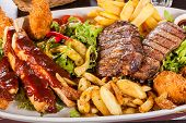 Platter Of Mixed Meats, Salad And French Fries