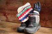 Childs Snow Boots With A Winter Cap And Gloves