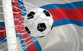 pic of faro  - Faroe Islands flag and soccer ball football in goal net - JPG