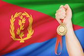 Medal In Hand With Flag On Background - State Of Eritrea