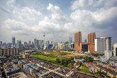picture of klcc  - Kuala Lumpur Malaysia Central Cityscape with Old Neighborhood Houses Against Cloudy Blue Sky - JPG