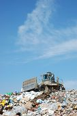 foto of waste management  - dump equipment on top of a pile of trash - JPG