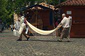 Men Carrying Hammock in Santa Fe, Colombia